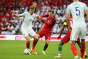 Portugal midfielder, Adrien Silva (23) battles for possesion with England midfielder, Eric Dier (17) during the Friendly International match between England and Portugal at Wembley Stadium, London, England on 2 June 2016. Photo by Matthew Redman.