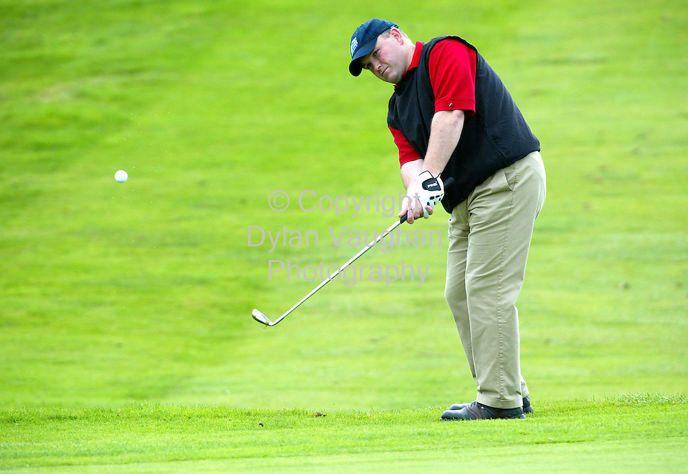 19/9/2004.Ger Manley of the Middleton team chips to the 13th at the IEI All Ireland Championships At Faithleg on Saturday..Picture Dylan Vaughan