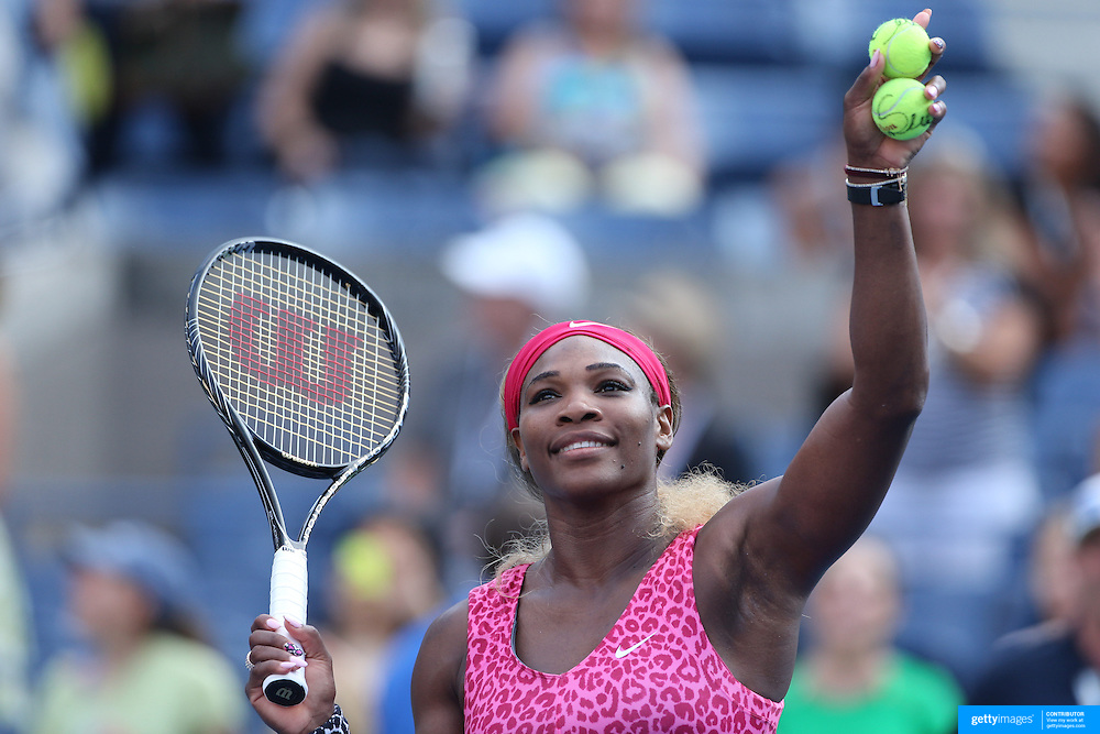 Serena Williams USA, hits balls into the crowd after her victory over Ekaterina Makarova, Russia, in the Women's Singles Semifinal during the US Open Tennis Tournament, Flushing, New York, USA. 5th September 2014. Photo Tim Clayton