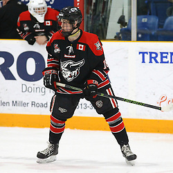 """TRENTON, ON  - MAY 5,  2017: Canadian Junior Hockey League, Central Canadian Jr. """"A"""" Championship. The Dudley Hewitt Cup Game 7 between Georgetown Raiders and the Powassan Voodoos.   Jack Hughes #16 of the Georgetown Raiders watches the play during the first period<br /> (Photo by Alex D'Addese / OJHL Images)"""