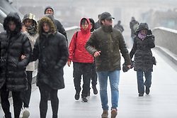 © Licensed to London News Pictures. 09/02/2020. LONDON, UK.  People brave the elements on Millennium Bridge as Storm Ciara brings strong winds and rain to much of the UK.  The Met Office has issued yellow and amber warnings for the country.  Photo credit: Stephen Chung/LNP