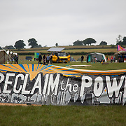 Reclaim the Power camp is set up in a field near Balcombe. The site is squatted but so far nor the owner nor police has made any moves to stop the camp from setting up. It is organised by the environmental group No Dash for Gas and the movement is protesting against the company Cuadrilla's fracking testing near Balcombe and have come to Balcombe to len its support to the local protests against the drilling for gas.