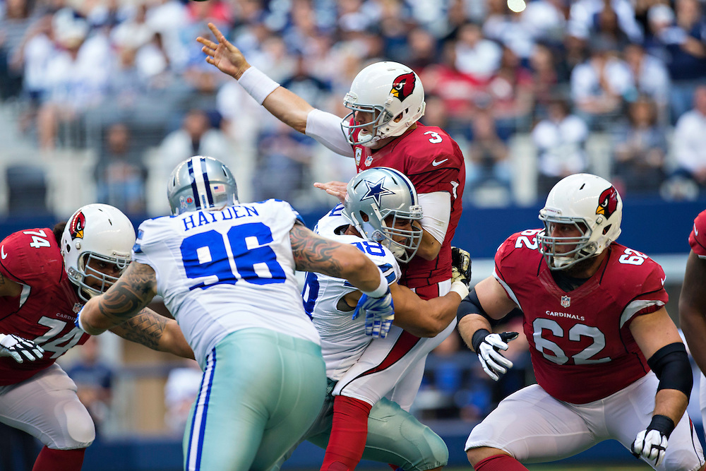 ARLINGTON, TX - NOVEMBER 2:  Carson Palmer #3 of the Arizona Cardinals is hit by Tyrone Crawford #98 of the Dallas Cowboys while throwing a pass in the first quarter at AT&T Stadium on November 2, 2014 in Arlington, Texas.  The Cardinals defeated the Cowboys 28-17.  (Photo by Wesley Hitt/Getty Images) *** Local Caption *** Carson Palmer; Tyrone Crawford