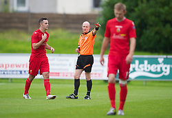 LLANELLI, WALES - Saturday, September 15, 2012: Llanelli's Luke Bowen is shown the red card and sent off by referee A.P. Harms during his side's 3-0 defeat by Newtown during the Welsh Premier League match at Stebonheath Park. (Pic by David Rawcliffe/Propaganda)