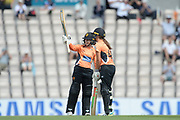 Tammy Beaumont of Southern Vipers raises her bat as she is congratulated by Amelia Kerr on reaching her half century during the Women's Cricket Super League match between Southern Vipers and Yorkshire Diamonds at the Ageas Bowl, Southampton, United Kingdom on 8 August 2018.