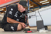 Emirates Team New Zealand sailor Ray Davies prepares his A Class catamarans for the upcoming National championships  and World championships regattas being sailed at Takapuna in Auckland. 5/2/2014
