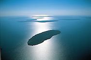 Wisconsin. Apostle Nat. Lakeshore, Lake Superior, Islands, Aerial, Sunrise, These United States page 72 left
