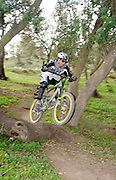Mountain Bikers at a dirt track event panned to emphasise motion
