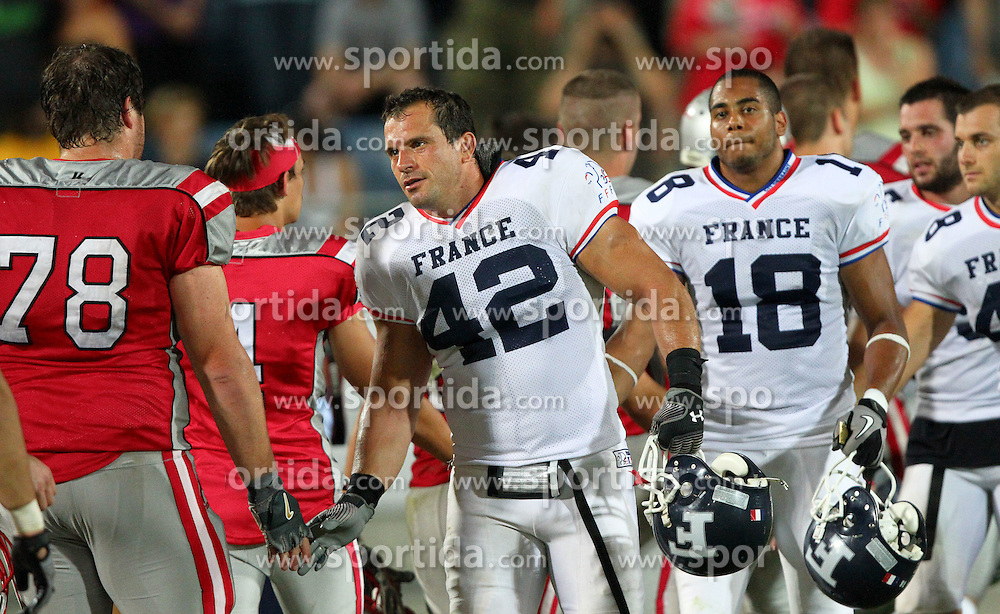 13.07.2011, UPC Arena, Graz, AUT, American Football WM 2011, Group B, Austria (AUT) vs France (FRA), im Bild shakehands after the game between Thomas Tippold (Austria, #78, OL) and Cédric Cotar (France, #42, LB )  // during the American Football World Championship 2011 Group B game, Austria vs France, at UPC Arena, Graz, 2011-07-13, EXPA Pictures © 2011, PhotoCredit: EXPA/ T. Haumer