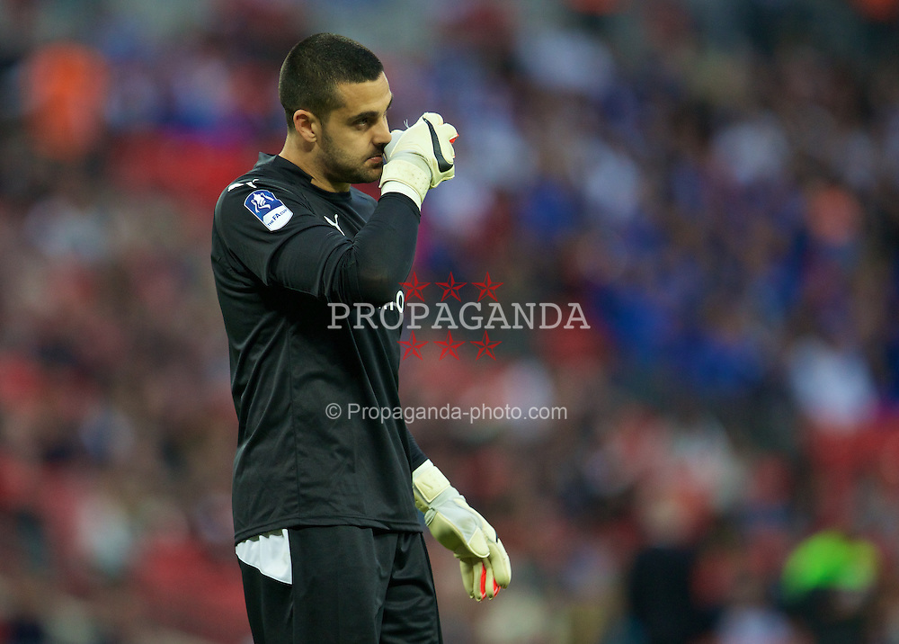 LONDON, ENGLAND - Saturday, April 18, 2015: Reading's goalkeeper Adam Federici looks dejected after his mistake gifted Arsenal a 2-1 extra time victory of the FA Cup Semi-Final match at Wembley Stadium. (Pic by David Rawcliffe/Propaganda)