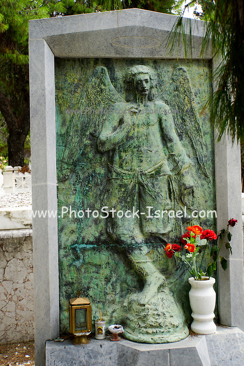weeping angel statue at a Cemetery Athens, Greece