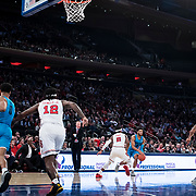 January 9, 2018, New York, NY : The St. John's and Georgetown men's basketball teams compete during Tuesday night's matchup between the Hoyas and Red Storm at the Garden. St. John's head coach Chris Mullin is visible, courtside, in dark suit and red tie. In something of a rematch of their 1985 contest, Basketball greats Patrick Ewing and Chris Mullin returned to Madison Square Garden on Tuesday night to face off as coaches with their respective Georgetown and St. John's teams.  CREDIT: Karsten Moran for The New York Times