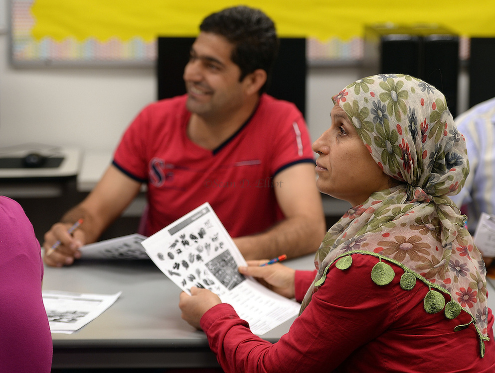 1005612433 :: 7/27/16 :: REGION :: LYNCH :: Hassan Mahmud and his wife Fahima Jmoo attend English for Speakers of Other Languages class at New London Adult and Continuing Education Wednesday, July 27, 2016. Mahmoud, Jmoo and their children Hanif, Fidan and Fulla  are refugees from the conflict in Syria and lived for three years in Turkey before finally receiving approval to come to the United States. Ledyard Congregational Church is hosting the family and providing support. (Sean D. Elliot/The Day)