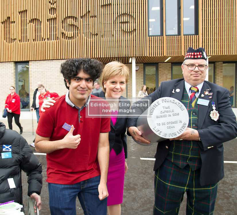Pictured: Rameez, who will return in 2044 to dig up the capsule, Nicola Sturgeon and one of the 'men in sheds'<br /> <br /> The First Minister Nicola Sturgeon, MSP, joined people supported by the Thistle Foundation to bury a time capsule to mark the opening of a new health and social care centre. <br /> Ger Harley   EEm 14 June 2016