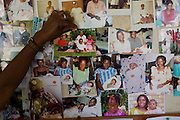 A photo of Harriet Nabatte and her children being added to the notice board that shows families who have been treated at the fistula camps at Kitovu Hospital, Uganda.