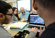 Giovanni Maldonado (left), 16 and Kesean Kennedy (right), 15 work on a project as Alena Garza (2nd from left) gets help from instructor Rich Staniec during science class Friday, March 17, 2017 at Upper Perkiomen High School in Pennsburg, Pennsylvania. (WILLIAM THOMAS CAIN / For The Philadelphia Inquirer)