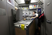 British airway stewardess at work in the airplanes kitchen