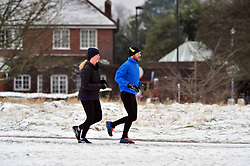 © Licensed to London News Pictures.18/03/2018<br /> Chislehurst, UK.<br /> Runners out in the morning snow on Chislehurst Common, Chislehurst, Kent<br /> Photo credit: Grant Falvey/LNP