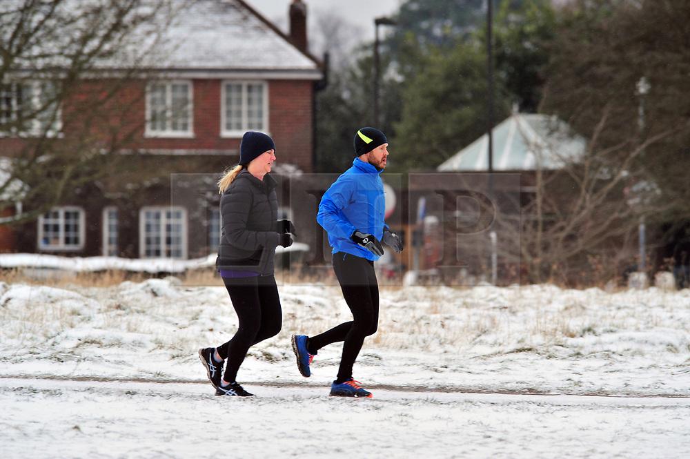 © Licensed to London News Pictures.18/03/2018<br /> Chislehurst, UK.<br /> Runners out in the morning snow on Chislehurst Common, Chislehurst, Kent<br /> Photo credit: Grant Falvey/LNP