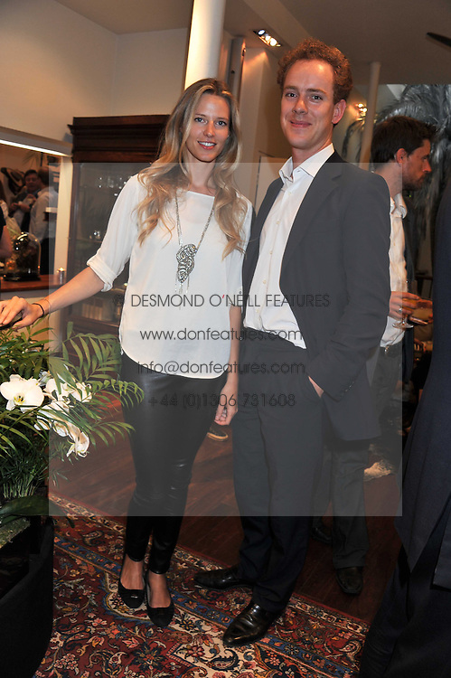 OLIVIA HUNT and TOM INSKIP at a party to celebrate the launch of the new Mauritius Collection of jewellery by Forbes Mavros held at Patrick Mavros, 104-106 Fulham Road, London SW3 on 5th July 2011.