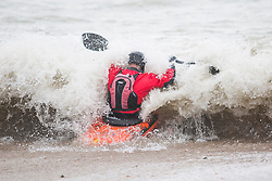 © Licensed to London News Pictures. 11/03/2018. Brighton, UK. Members of the Martlets Kayak Club take advantage of the powerful waves to spend some time in the sea in Brighton and Hove. Photo credit: Hugo Michiels/LNP