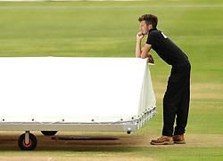 A member of the ground staff at Gloucestershire waits to take the covers off the pitch - Mandatory by-line: Robbie Stephenson/JMP - 07966386802 - 04/08/2015 - SPORT - CRICKET - Bristol,England - County Ground - Gloucestershire v Durham - Royal London One-Day Cup