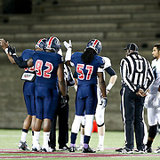 The coin toss takes place prior to the first ever Boston Brawlers home game at Harvard Stadium on October 24, 2014 in Boston, Massachusetts. (Photo by Elan Kawesch)