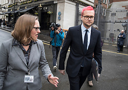 © Licensed to London News Pictures. 27/03/2018. London, UK. Christopher Wylie (R), the Cambridge Analytica whistleblower, arrives at Portcullis House to appear before a Select Committee. Cambridge Analytica has been implicated in an investigation into the misuse of Facebook user data to influence the electoral outcomes, including the Brexit referendum. Photo credit: Peter Macdiarmid/LNP