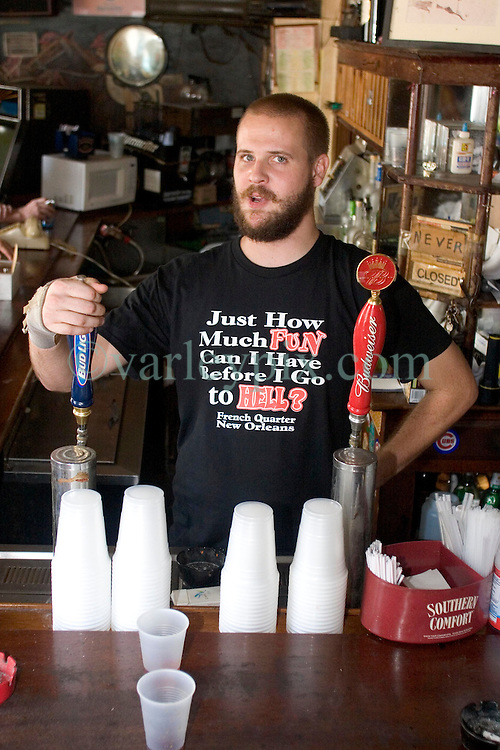 03 Sept  2005. New Orleans, Louisiana. Post hurricane Katrina.<br /> Johnny White's Sports Bar on Bourbon Street in the French Quarter - with it's claim to &quot;Never Close.&quot; The bar has remained open throughout.  Barman Jo Bellomy at the helm.<br /> Photo Credit &copy;: Charlie Varley/varleypix.com