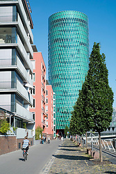 The Westhafen modern upmarket residential and business property development with many apartment buildings around harbour in Frankfurt Germany