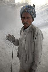 Chitrakoot District, Uttar Pradesh, India: A portrait of a stone worker int the Chitrakoot District of Uttar Pradesh, India.  (Photo by Ami Vitale)