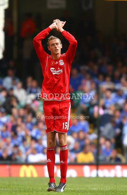 CARDIFF, WALES - SUNDAY, AUGUST 13th, 2006: Liverpool's Peter Crouch applauds the fans as he is substituted against Chelsea during the Community Shield match at the Millennium Stadium. (Pic by David Rawcliffe/Propaganda)