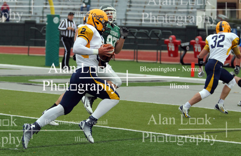 18 October 2014:  Sam Frasco scrambles right to make it to the end zone during an NCAA division 3 football game between the Augustana Vikings and the Illinois Wesleyan Titans in Tucci Stadium on Wilder Field, Bloomington IL