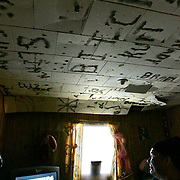 Gerald Mattinas at his house. Writing is burned in the ceiling with lighters. <br /> <br /> (Ian Stewart photo)