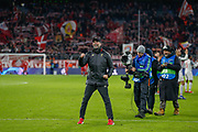 Liverpool manager Jurgen Klopp pumps his fist towards the travelling Liverpool fans after the Champions League match between Bayern Munich and Liverpool at the Allianz Arena, Munich, Germany, on 13 March 2019.