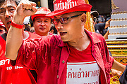 28 APRIL 2014 - BANGKOK, THAILAND: Thai Red Shirt activists at the funeral for Kamol Duangphasuk, 45, in Bangkok. Kamol was a popular poet who wrote under the pen name Mai Nueng Kor Kunthee. Kamol had been writing since the 1980s and was an outspoken critic of the 2006 coup that deposed Thaksin Shinawatra. After the 2010 military crackdown against the Red Shirts he went into temporary self imposed exile fearing for his safety. After he returned to Thailand he organized weekly protests against Thailand's Lese Majeste laws, which he said were being used to stifle dissent. Kamol was shot and murdered on April 23. The assailants are still at large but the murder is thought to be political.     PHOTO BY JACK KURTZ