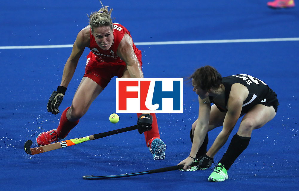 RIO DE JANEIRO, BRAZIL - AUGUST 17:  Crista Cullen (L) of Great Britain is challenged by Kelsey Smith during the Women's hockey semi final match betwen New Zealand and Great Britain on Day12 of the Rio 2016 Olympic Games at the Olympic Hockey Centre on August 17, 2016 in Rio de Janeiro, Brazil.  (Photo by David Rogers/Getty Images)