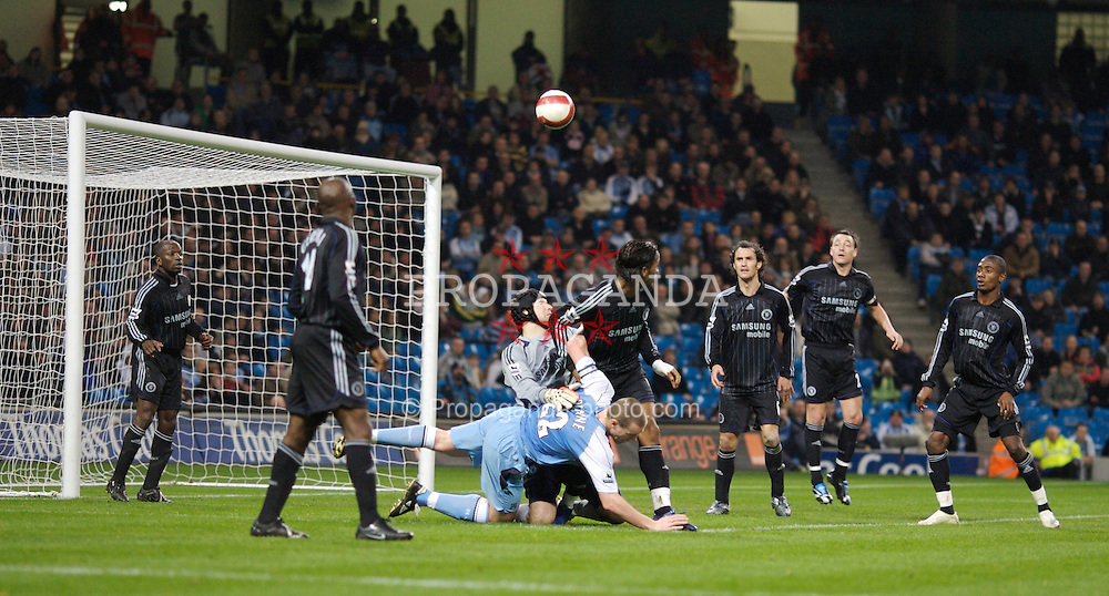 Manchester, England - Wednesday, March 14, 2007: Manchester City's Richard Dunne is brought down by Chelsea's goalkeeper Petr Cech during the Premiership match at the City of Manchester Stadium. (Pic by David Rawcliffe/Propaganda).