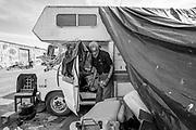 Navy veteran Allen Bridges grabs food utensils out of his broken down camper van near Wood Street and 26th Street on Wednesday, May 24, 2017, in Oakland, Calif.