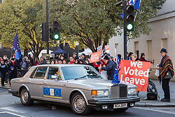 London, UK. 11th December, 2018. Pro-Brexit activists jeer at the occupants of a Rolls Royce adorned with pro-EU stickers and an EU flag during rival protests outside Parliament on the day on which a vote was originally to have been scheduled on completion of a House of Commons debate on the Government's draft Brexit withdrawal agreement.