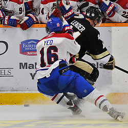 COBOURG, ON - Oct 19: Ontario Junior Hockey League game between Kingston Voyageurs and Trenton Golden Hawks. Graham Yeo #16 of the Kingston Voyageurs and Alex Leader #44 of the Trenton Golden Hawks battle for the puck during third period game action..(Photo by Shawn Muir / OJHL Images)