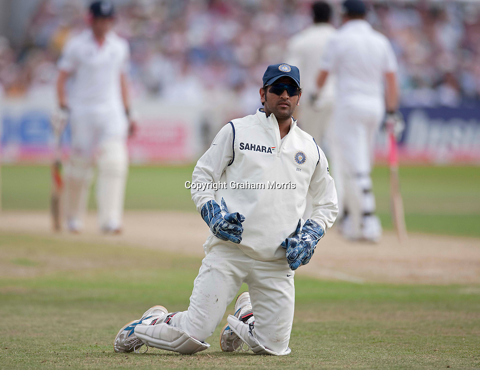 Captain Mahendra Singh Dhoni fails to stop a four off the reinstated Ian Bell (after being run out the last ball before tea) in the second npower Test Match between England and India at Trent Bridge, Nottingham.  Photo: Graham Morris (Tel: +44(0)20 8969 4192 Email: sales@cricketpix.com) 31/07/11