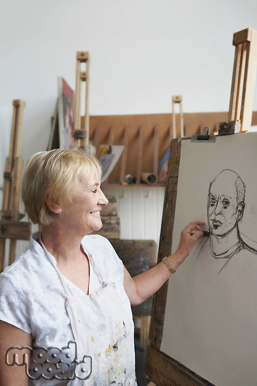 Senior woman in art class