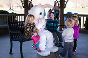 The Easter Bunny takes photos with families during the 21st Annual Easter Egg Hunt at Winnequah Park in Monona, WI on Saturday, April 20, 2019.