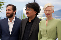 Director Bong Joon Ho, actress Tilda Swinton and actor Jake Gyllenhaal at the Okja film photo call at the 70th Cannes Film Festival Friday 19th May 2017, Cannes, France. Photo credit: Doreen Kennedy