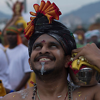 HIndu devotee in a trance as he walk to the Batu Cave temple during a Thaipusam festival in Kuala Lumpur, Malaysia, 03 Fenruary 2015.  Thousands of Hindus gather to participate in the annual Thaipusam festival dedicated to Lord Murugan. During Thaipusam day, devotees will fulfilled their vows by carrying 'kavadi (bearers had spikes pierced into their bodies) or pots of milk as offering to Lord Murugan. The devotees will make the arduous climbing up the 272 steps leading up to the temple cave and deposited at the feet of the deity to purify themselves.he temple cave and deposited at the feet of the deity to purify themselves.