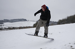© Licensed to London News Pictures. 01/02/2019. High Wycombe, UK. A man snowboards in wintry conditions after overnight snow falls and continuing low temperatures. Photo credit: Peter Macdiarmid/LNP
