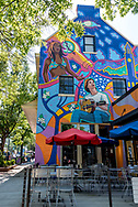 Colorful mural on wall beside outdoor dining in downtown Chapel Hill.