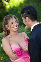 Teenage Girl Pinning Boutonniere on Date