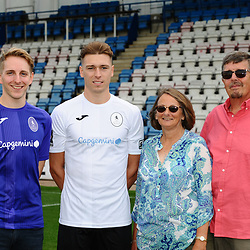 AFC Telford United pre-season photoshoot at the New Bucks Head Stadium on Thursday, August 1, 2019<br /> <br /> Henry Cowans with sponsors the Preston family<br /> <br /> Free for editorial use only<br /> Picture credit: Mike Sheridan/Ultrapress<br /> <br /> MS201920-004